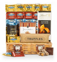 Indulge the chocolate lover with this best-selling assortment of world famous chocolates and gourmet confections. Paired with sweet companions, this gift creates a celebration that is truly decadent.